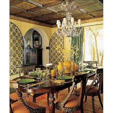 this dining room is full of intricate details and wonderfully crafted furniture the indian side chairs regency chandelier and vintage yellow vases are