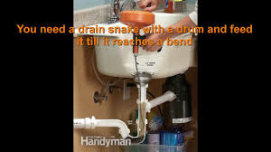 how to use drain snake clogged kitchen sink unclog bathroom toilet trap pipe