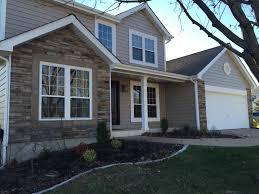 insulated vinyl siding stone veneer replacement window pvc trim boards and fiberglass entry door