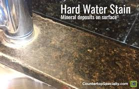 hard water stains on kitchen countertop around faucet