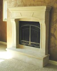 white stone fireplace mantel shelf with black metal fire box on grey wall
