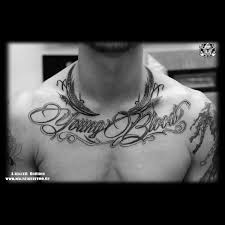 надписи на груди Tattoo Magnum