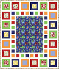 Dino-Mite Quilt Pattern and Quilt Kit | Quilts | Pinterest ... & Free Quilt Pattern - Dino-Mite Free Quilt Pattern - Fat Quarter Shop Did it  in a custom crib size with a fish panel in the center. Adamdwight.com
