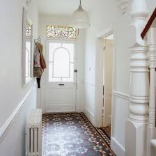 Victorian hallway with encaustic tiles and stained glass door