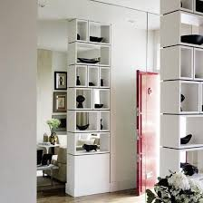 Shelving unit with shelves separating bedroom from living area