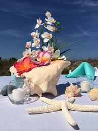 Creative Idea:Awesome Conch Seashell Wedding Table Centerpiece Feat  Beautiful White Orchid Awesome Conch Seashell