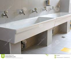 preschool bathroom design. Preschool Bathroom Sink. Series Of Small Taps In The Kindergarten. Sink Design