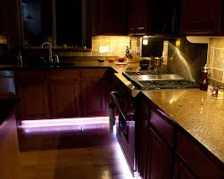 under kitchen cabinet by the floor led lighting or a rope light