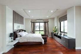 dark bedroom furniture. traditional bedroom design with white walls ceiling dark furniture wood floor a