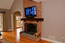 mounting tv above brick fireplace home design ideas contemporary