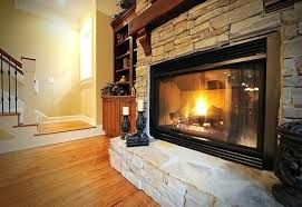 convert fireplace to gas burning a bright fire burning in a gas insert fireplace with a stone veneer how to change a gas fireplace back to wood burning