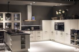 white cabinets with gray countertop dark brown brick backsplash