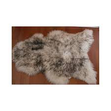 brown white sheepskin rug