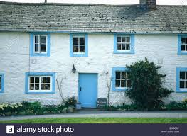 cottage front doorsTraditional white cottage with bluepainted front door and windows