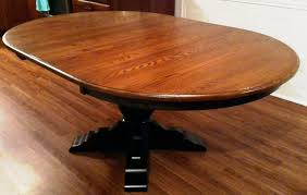 albany single pedestal dining table is normally round but it accepts leaves this table is