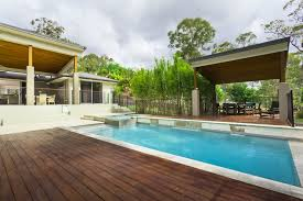 wood patio with pool. Contemporary Home With Backyard Pool Rich Wood Patio And Large Gazebo