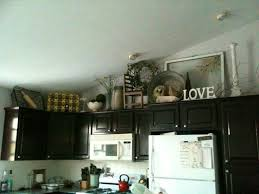 Decorations On Top Of Kitchen Cabinets Awesome Decorating Above Kitchen Cabinet Antiques Nature Decorating
