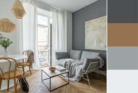 some of the best accent wall color combinations are light and serene like in this room that utilizes a grayscale grant with a darker accent wall next