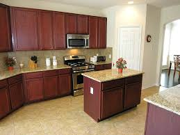 cherrywood kitchen designs. simple and neat u shape kitchen ideas using dark cherry wood cabinet along with small island cream granite counter tops cherrywood designs e