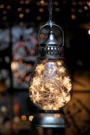 hang a lantern filled with a strand of le lights it looks like fire flies