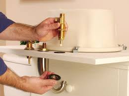 assemble the faucet and valve components ideally working with the countertop turned upside