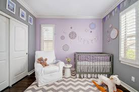 newborn baby girl pics with transitional nursery and armchair baby bedding baby decor bunting chevron rug grey pink purple modern crib owl decor rocking