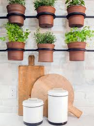 Adorable ceramic plant stand ideas for garden Planters Black Metal Mounts And Ceramic Pots For Indoor Herb Garden In Bright White Kitchen Hgtvcom Container Gardening Ideas From Joanna Gaines Hgtvs Decorating