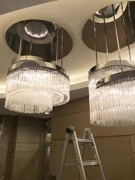 Light Fixtures Miami Fl Cleaning Oversized Chandelier At The Lobby Commercial