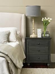 dark grey side table with grey lamp and white flowers