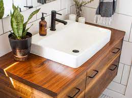A vanity can also be sliced and sculpted to shelter it. 35 Wooden Bathroom Ideas