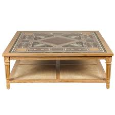 cerused mahogany coffee table with inlaid marble top and cane shelf for