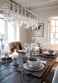 neutral dining room white cream dishes candels bird print chandelier fur throw cozy nest home soft romantic natural light wood rustic table