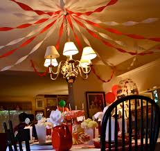 the big top was the dining room where the centerpiece was the aforementioned carousel cake we hung streamers to recreate the tent ceiling