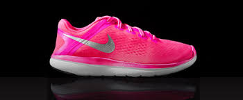 nike running shoes for girls. a nike flex 2016 junior girls running shoe in front of black bacground shoes for