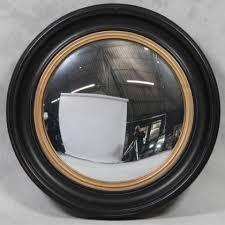 large black convex mirror round black