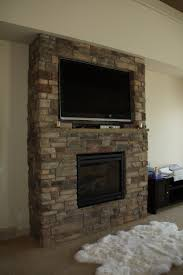 furniture fireplace designs with tv above living room layout and brick wall on top fireplac