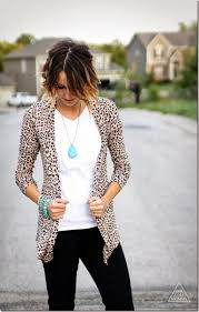fashion leopard cardigan with black skinny jeans white top and turquoise jewelry