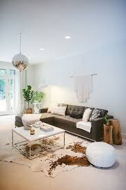 living room ideas with cowhide rug. 6 reasons layering rugs will make your home more stylish living room ideas with cowhide rug o