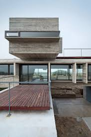 Concrete house by Luciano Kruk stands on seaside golf course. Golf PicturesMinimalist  ArchitectureModern ...