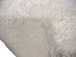 white fuzzy carpet. greek flokati wool rug. white fuzzy carpet