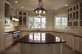 tan kitchen cabinets with black granite countertops