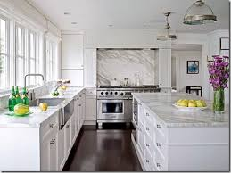 white kitchen counter. obsessed with this kitchen -- dark wood floors, marble backsplash, counters, white transitional cabinets, stainless appliances counter