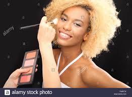 make up artist painting a beautiful woman professional makeup makeup artist paints a