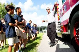 Imagine School at Town Center hosts first-ever safety day with hands-on  learning - Flagler County Fire Rescue's Ivan Grant talks to Imagine  School students about the fire truck's features. Photo by Paige Wilson    Palm Coast Observer
