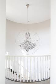 foucaults orb clear crystal chandelier in winding staircase