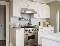 Gorgeous ivory kitchen design with creamy white kitchen cabinets, white  carrara marble subway tiles backsplash, white carrara marble counter tops,  ...