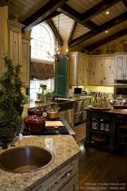 french country kitchen vaulted ceilings shutters chandelier and copper sink