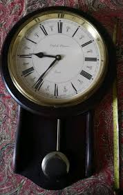 traditional pendulum wall clock in