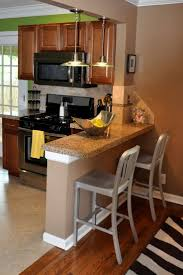 Kitchens:White Modern Kitchen With Wood Breakfast Bar Table And Black Bar  Stools Traditional Style
