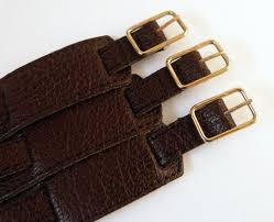 gold buckles on brown montana leather